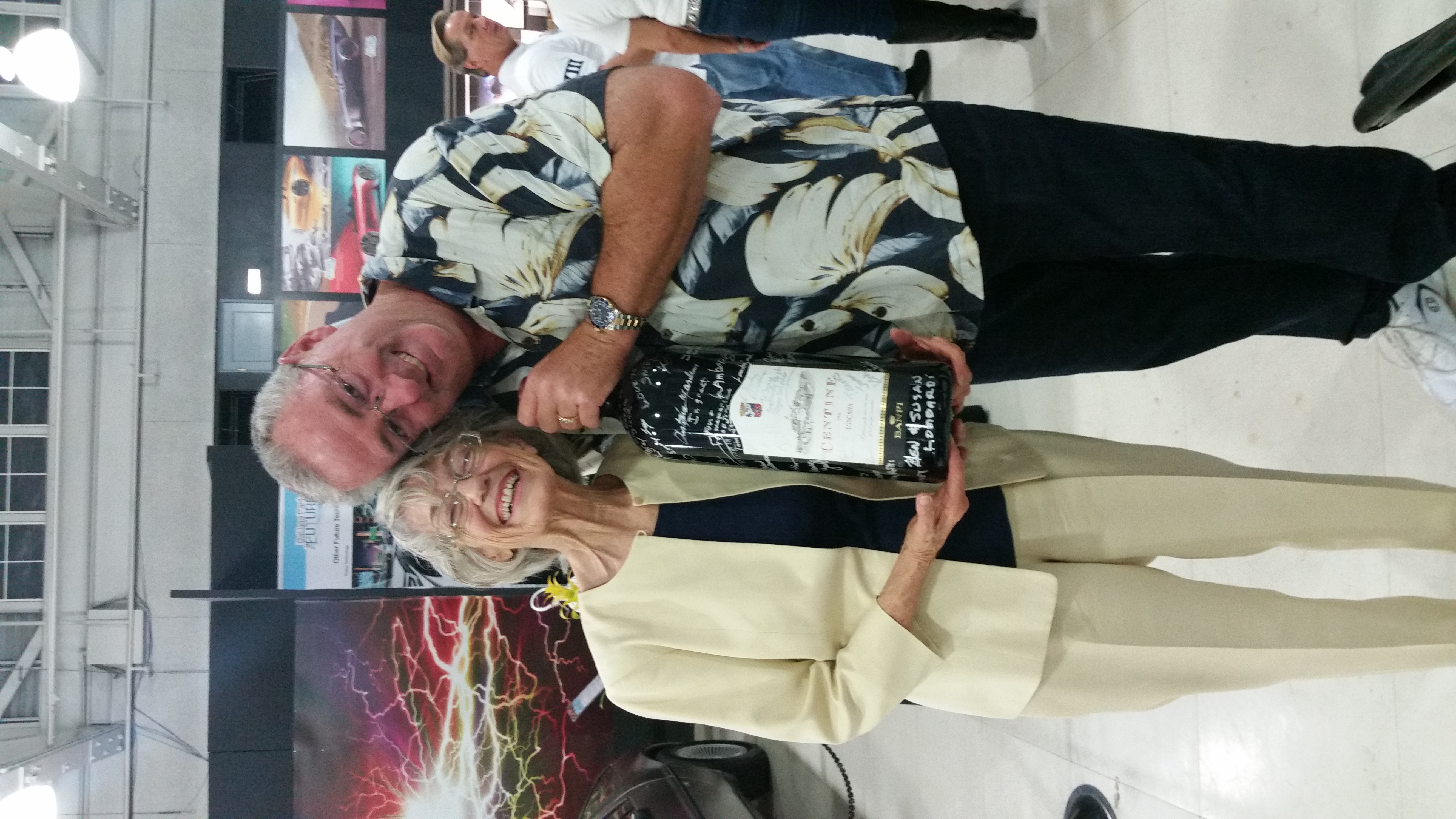Scott Reiner with Joan an the Big, Signed Bottle of Wine